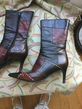 italian leather boots, patchwork from dark brown to brown and dark red.