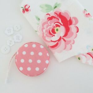 Fabric covered retractable soft tape measure pocket sewing pink polka dots