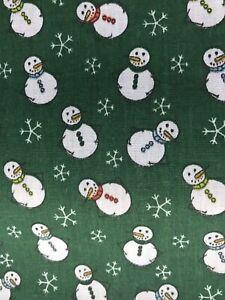 CHRISTMAS green snowflake/snowman design poly cotton fabric