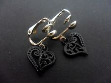 A PAIR OF CUTE LITTLE DANGLY BLACK HEART SILVER PLATED CLIP ON EARRINGS.
