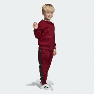 adidas Originals infant burgundy Debossed crew neck suit. Ages 5-6 years