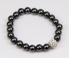 Grey magnetic hematite bracelet, feature silver rhinestone bead. Elasticated.