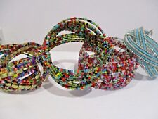 FOUR SIMILAR AFRICAN THEMED TINY COLOURFUL BEADS RIGID OPEN BRACELETS QUITE WIDE