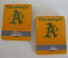 """OAKLAND A'S """"THE SWINGIN' A'S"""" MATCHBOOKS W/SCHEDULE UNUSED LOT OF 2 **READ AD"""