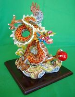 Colorful Chinese Dragon Statue Flying on Cloud and Chasing one Red Ball