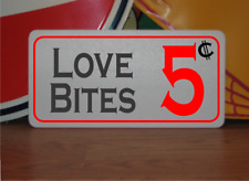 Love Bites 5 cents Metal Sign