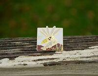 Alaska State Bird Mosquito Carrying Fish Gold Tone Metal Enamel Pin Pinback