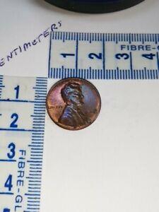 """1968 USA ONE CENT 1¢, """"S"""" mint mark, error coin (foreign matter imprint)."""