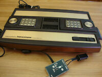 INTELLIVISION MODEL 2609 COMPLETE WITH TWO CONTROLLERS AND AUTO RACING GAME