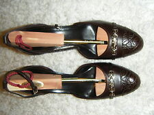 GUCCI CHOCOLATE 3.5 INCH HEEL WITH GOLD GUCCI ON FRONT WORN TWICE $650  WOW