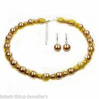 Gold Metallic Necklace Earring Set Glass Pearl Bead And Ribbon Design