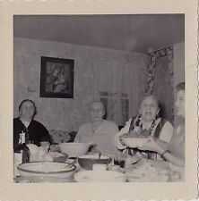 Vintage Antique Photograph Older People Passing Food Dishes in Retro Dining Room