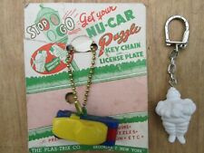 (2) Vintage Keychains Plas-Trix Nu-Car Puzzle On Card, Michelin Tires From 1960