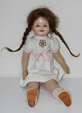 MU022 PORCELAIN DOLL. RAG BODY. MARKED IN THE NAPE. GERMANY. EARLY 20th CENTURY