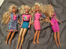 Lot of 4 Barbie Dolls