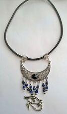 Egyptian Eye of Horus pendant necklace on leather cord, with Lapis gemstones