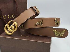 Gucci beige belt with golden tone creatures