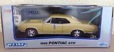 1966 Pontiac GTO Welly 1:18 diecast muscle car model 9856W gold new w/ bands