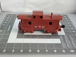Marx O Scale red NYC caboose. 2 axle caboose, with smoke stack.