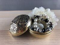 Vintage polished brass round lidded trinket box with pressed flowers display