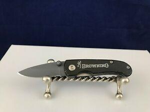 Browning 2118 pocket knife drop point plain edge blade liner lock black handle