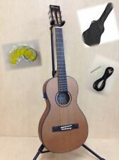 Caraya Parlor Guitar 610 Natural Cedar With EQ Gig Bag Strings