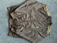 Mens brown and tan Adidas tracksuit top size large. Used but in good condition.