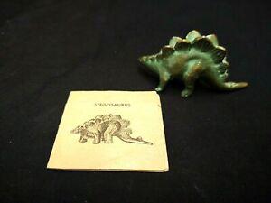 VINTAGE 1940S SRG GREEN BRONZED LEAD METAL STEGOSAURUS FIGURINE W/PAPER CARD