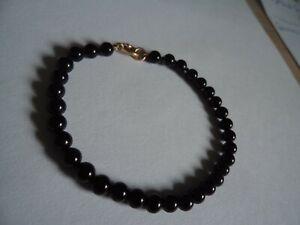 black jet/beads bracelet with 9ct gold clasp