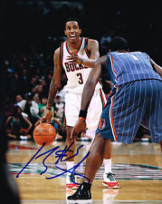 BRANDON JENNINGS  signed MILWAUKEE BUCKS 8X10 PHOTO COA