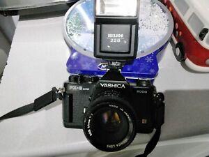 yashica fx-3 camara and hellos flash unit 228
