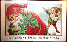 1914 Postcard Santa Holding Holly Barries Elf Throwing Snowball Over S. Claus