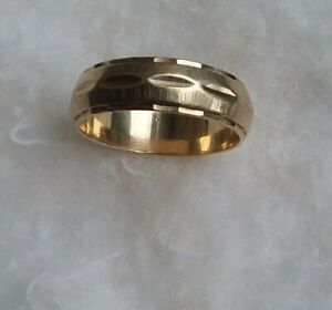 Gold Band 14K size 8. Six mm width. Wt. 4.8 g.