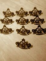 Lot of 10 brass deco looking drawer pulls.  Great patina. model # 4686