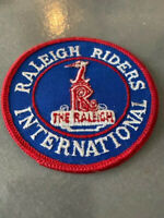 RALEIGH INTERNATIONAL BICYCLE COMPANY VINTAGE OLD SCHOOL  NOS PATCH  BLUE RED