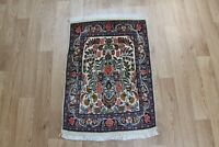 A beautiful handmade Persian Rug with a pleasing floral vase design 80 x 60 cm