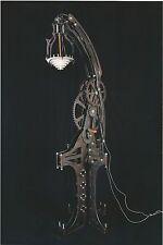 steampunk style giant steel mechanical lamp with tall base. industrial age art