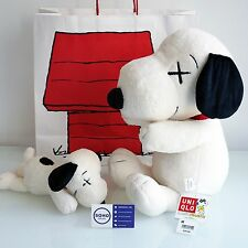 KAWS x PEANUTS x UNIQLO SNOOPY PLUSH TOY SET OF 2 - SMALL & LARGE - IN HAND