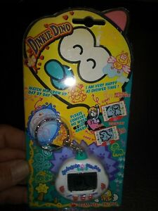 RakuRaku DinoKun Dinkie Dino Electronic Virtual Pet Tamagotchi TK-910 White NEW