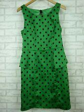 Review Pencil peplum dress Emerald green Black polka dot Bow back Sz 12
