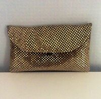 Gold and black sequin clutch bag