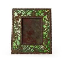 A Tiffany Studios 'Grapevine' picture frame Lot 1069