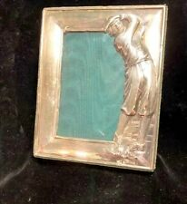 ENGLISH STERLING SILVER FRAME FEATURING A GOLFER IN MID SWING (HALLMARKED)