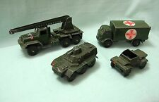 FOUR DINKY MILITARY..AMBULANCE/SCOUT CAR/ARMORED PERSONEL CARRIER/MISSILE TRUCK