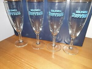 4 Vintage Goldwell Snowball Glasses Gold Rims and Blue Lettering.