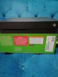 Console Xbox One X 1To Très Bon État Encore sous garantie Microsoft