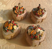 Set of 4 trinket boxes features guitar, banjo, violin, cello & other instruments
