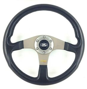 Genuine Momo Tuner black leather steering wheel with Land Rover centre.     7D