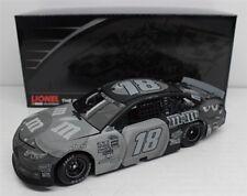 NASCAR ACTION KYLE BUSCH #18 BLACK M&MS STEALTH  1:24  DIECAST CAR