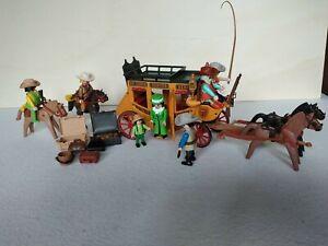 Playmobil 3803 Postkutsche mit 2 × Cowboys mit Pferde.